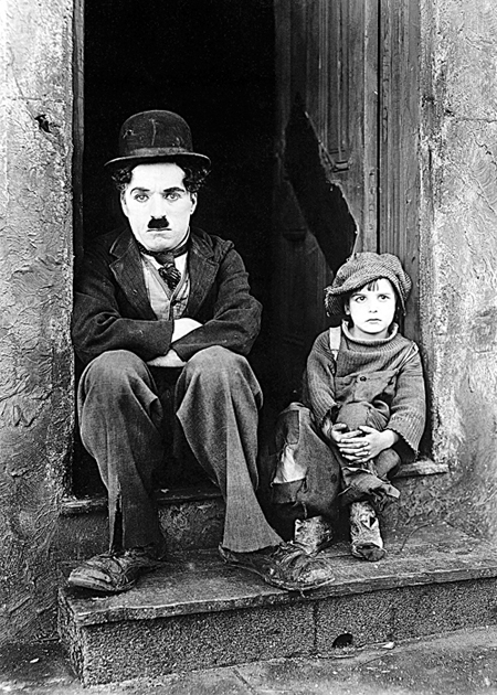 Charlie Chaplin and Jackie Coogan in The Kid 1921