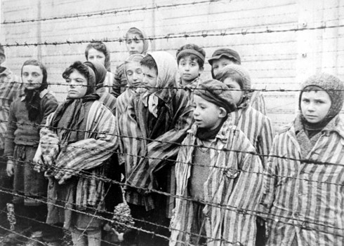 Child survivors at Auschwitz [Wikimedia]