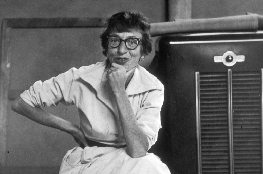 August 1953: Portrait of Abstract Expressionist artist Lee Krasner (1908 - 1984), wearing eyeglasses and seated next to a heater at her home in East Hampton, New York. (Photo by Tony Vaccaro/Hulton Archive/Getty Images)